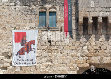 Flag on the wall above the south entrance of the Tour Monseigneur, part of the Chateau de la Bastide in Eymet, Dordogne - Stock Photo