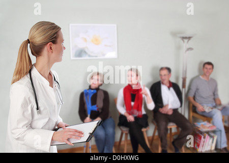 Waiting Room with doctor and full of patients - Stock Photo