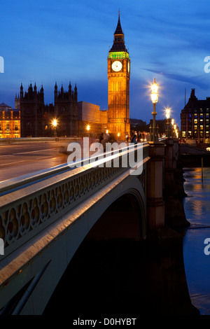 A night view across Westminster Bridge with Big Ben in the distance. - Stock Photo