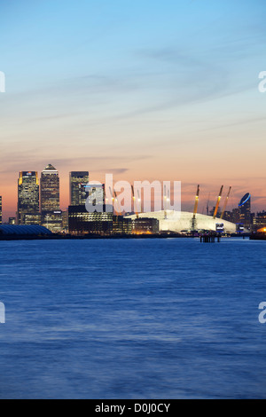 A view down the river Thames towards the City of London and the O2 Arena and Canary Wharf at sunset. - Stock Photo