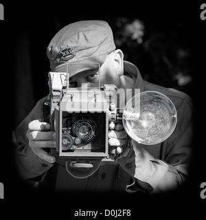 Official US War Photographer (Recreation) with US Combat Graphic 45  & with 127mm Kodak Anastigmat lens - Stock Photo
