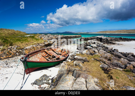 A view of a boat moored in an inlet at Eoligarry Pier. - Stock Photo