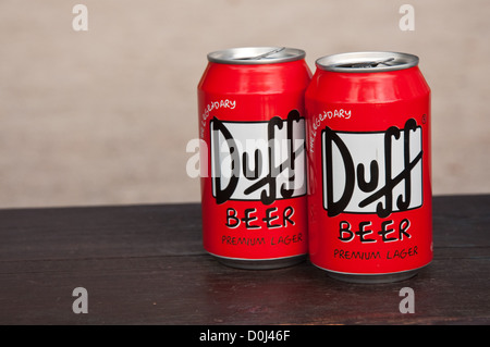 Two cans of famous Duff beer - Stock Photo