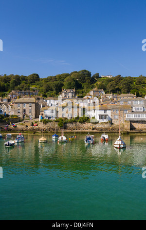 Yachts and boats moored in Mousehole harbour, Cornwall - Stock Photo