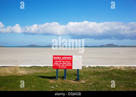 View of Barra Airport sign and Traigh Mhor beach which is used as the runway. - Stock Photo