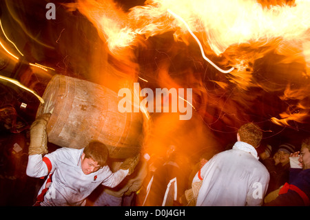 Rolling of the tar barrels in Ottery St Mary in Devon. - Stock Photo
