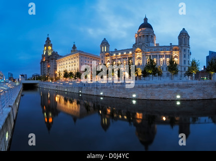 The Liver Building, The Cunard Building and the Port of Liverpool Building reflected in the Leeds-Liverpool Canal - Stock Photo