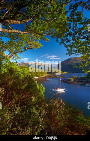 A yacht anchored in the calm waters of Loch Leven at Bishop's Bay. - Stock Photo