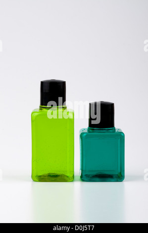 Two green color shampoo and bottles - Stock Photo