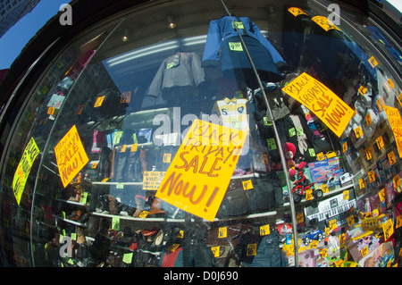 Signs in a store window say Black Friday Sale Now seen in the Herald Square shopping district in New York - Stock Photo