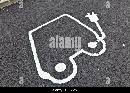 Painted road sign indicating electric car recharging point. - Stock Photo
