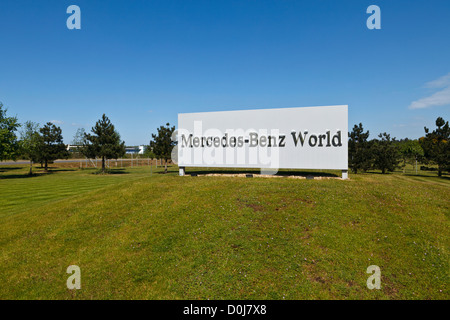The entrance sign to the Mercedes-Benz World facility at the former Brooklands airfield and racing track in Surrey. - Stock Photo