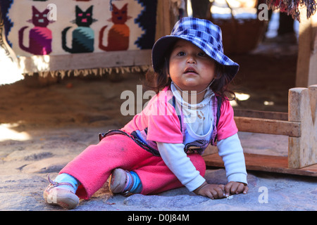 Young girl inranquil city life in Ollantaytambo, Sacred Valley, Cuzco province, Peru - Stock Photo