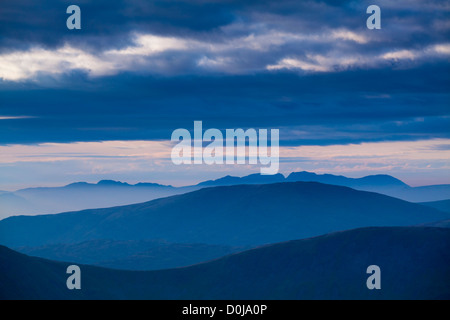 Mountain fog in the valleys of the western Lake District overlooked Scafell Pike. - Stock Photo