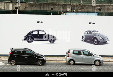 large advertisement for VW (Volkswagen) in the streets of Kuala Lumpur, Malaysia - Stock Photo
