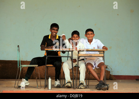 Sri Lankan schoolboys scoring an inter-school cricket match in Tissamaharama, Sri Lanka. - Stock Photo