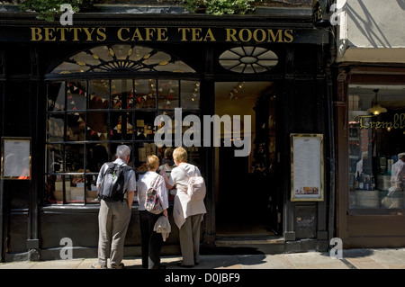 People looking in the window of Little Bettys cafe and tea rooms in Stonegate. - Stock Photo