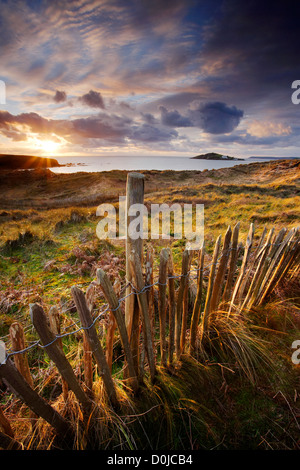 Sunset over Bantham dunes and Bigbury Bay in South Devon. - Stock Photo