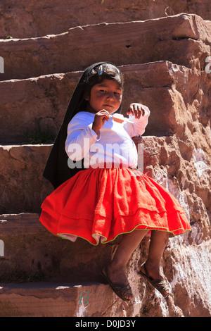 Little girl on Isla Taquile, Lake Titicaca, Peru - Stock Photo
