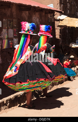 Two women in traditional costumes on Isla Taquile, Lake Titicaca, Peru - Stock Photo