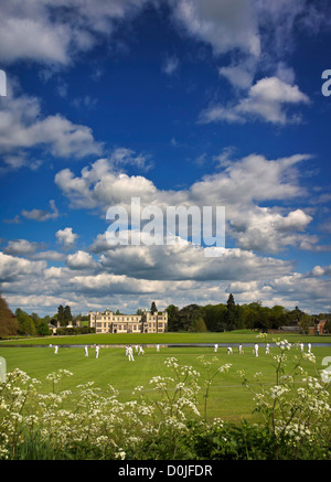 A cricket game being played in the grounds of Audley End. - Stock Photo