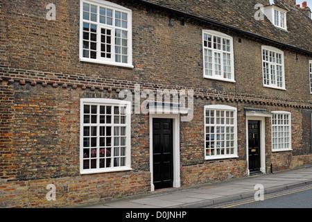 Old terraced houses built of brick in Waterside. - Stock Photo