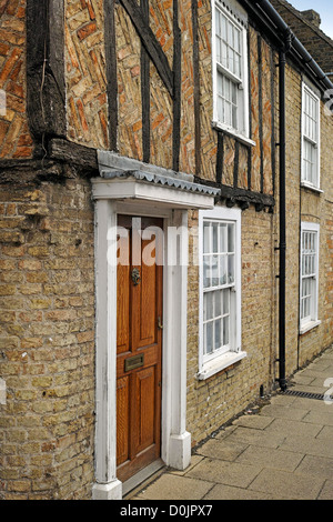 Old terraced house built of brick with timber frame in Waterside. - Stock Photo
