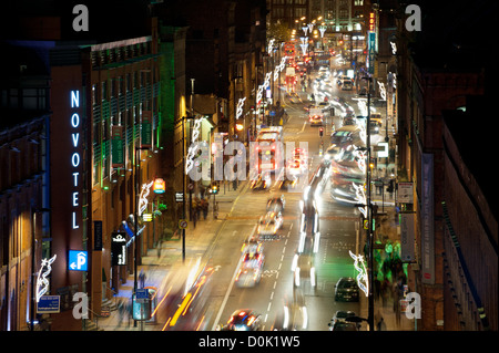 Looking down on Portland Street in Manchester. - Stock Photo