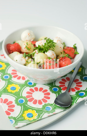 Watermelon with buffalo mozzarella - Stock Photo
