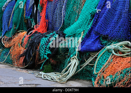 Colourful trawler fishing nets on the quay in Lyme Regis harbour along the Jurassic Coast, Dorset, southern England, - Stock Photo