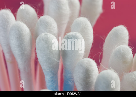 Close up of a group of cotton bud swabs. Focus concentrated on one bud. - Stock Photo