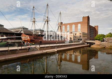 View of Tobacco Docks in Wapping with the replica of a tall ship called Three Sisters. - Stock Photo