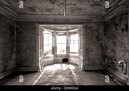 Empty derelict room in a mansion - Stock Photo