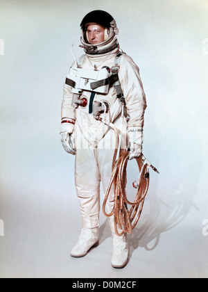 Extravehicular space suite worn Gemini 4 astronaut is shown on test subject.  Gold coated umbilical connects astronaut - Stock Photo