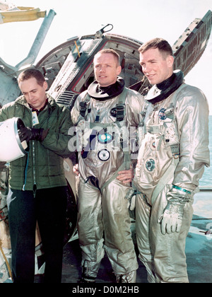 Astronauts Neil Armstrong and David R. Scott sit with ...