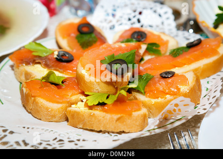 sandwiches with smoked salmon on a plate - Stock Photo