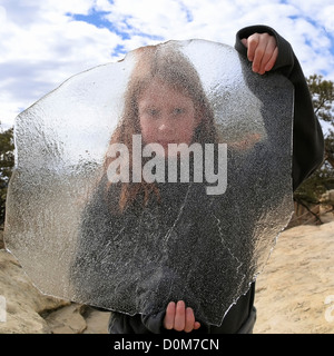 Girl with Sheet of Ice - Stock Photo