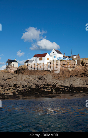 Fishermen's houses boarded up against storms on Ecrehous island off Jersey, Channel islands, UK - Stock Photo