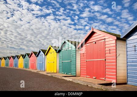 Colourful beach huts at Dawlish Warren in Devon - Stock Photo
