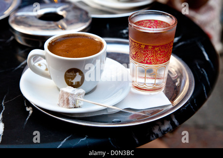Turkish coffee served with a piece of Turkish delight in the Kadıköy district of Istanbul, Turkey. - Stock Photo