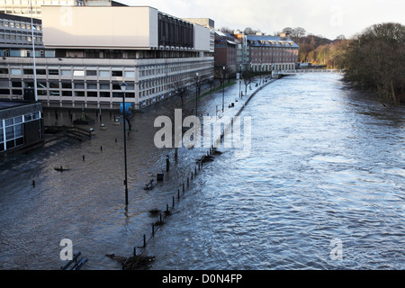 River Wear overflows and floods road within  Durham City adjacent to the National Savings and Investments building - Stock Photo