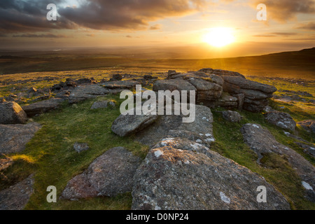 Sunset from Staple Tor casting a golden glow across the moorland looking towards Cox Tor. Dartmoor National Park, - Stock Photo