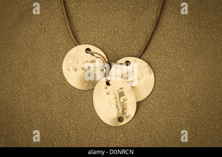 Genuine military identification dog tags issued in the UK during military service in Northern Ireland. - Stock Photo