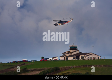 British International helicopter taking off from St Marys heliport in the  Isles of Scilly, Cornwall,UK - Stock Photo
