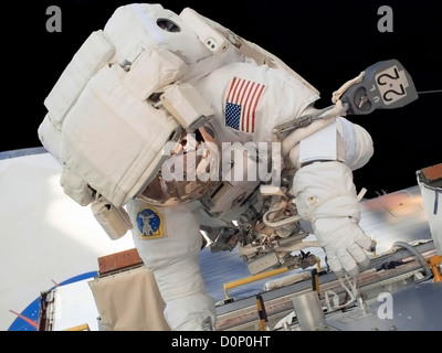 Astronaut Working on International Space Station - Stock Photo