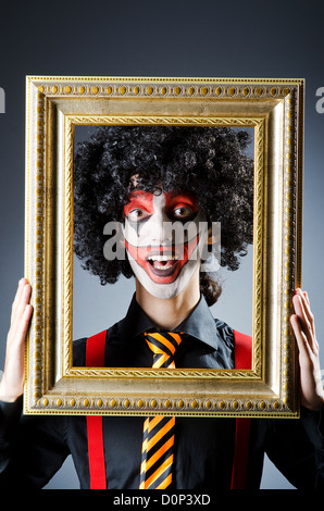 Clown With Picture Frames In Studio Stock Photo 91485805 Alamy