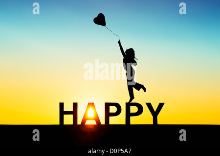 Young Girl jumping with a heart balloon on HAPPY letters. Silhouette. Montage of two images - Stock Photo