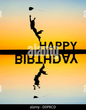Young Girl jumping with a heart balloon on HAPPY BIRTHDAY letters. Silhouette. Montage of two images - Stock Photo
