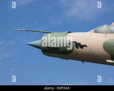 MIG 21 on the blue sky - Stock Photo