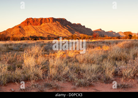 Sunrise on the West MacDonnell Range near Alice Springs - Stock Photo